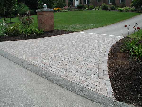 Distinctive stone paver or brick walkways and driveways for Base for concrete driveway
